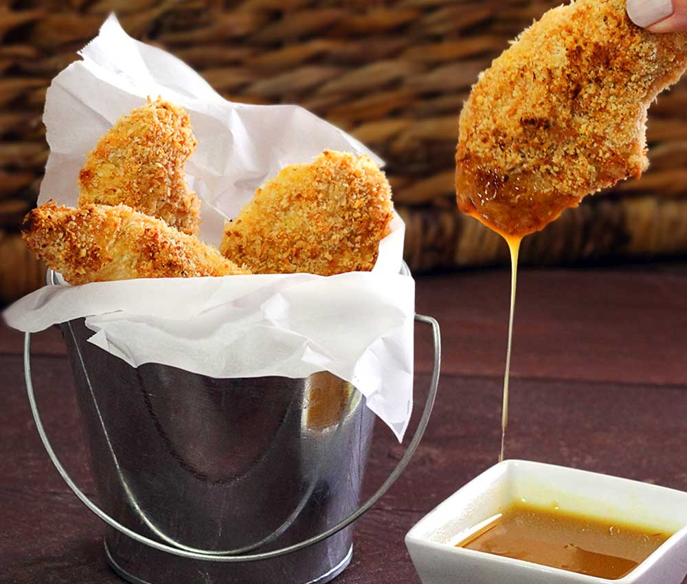 easy paleo and gluten-free recipe for baked chicken fingers with a quick honey-mustard dipping sauce