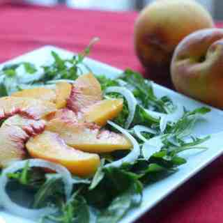 Summer Peach, Shaved Onion and Arugula Saladwith Honey-Lemon Vinaigrette
