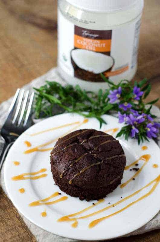 paleo mocha fudge cake with jar of coconut oil