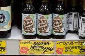bottles of organic coconut aminos on shelf