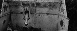 Ernesto Bazan ISLABoy hanging upside down, Trinidad, 2005