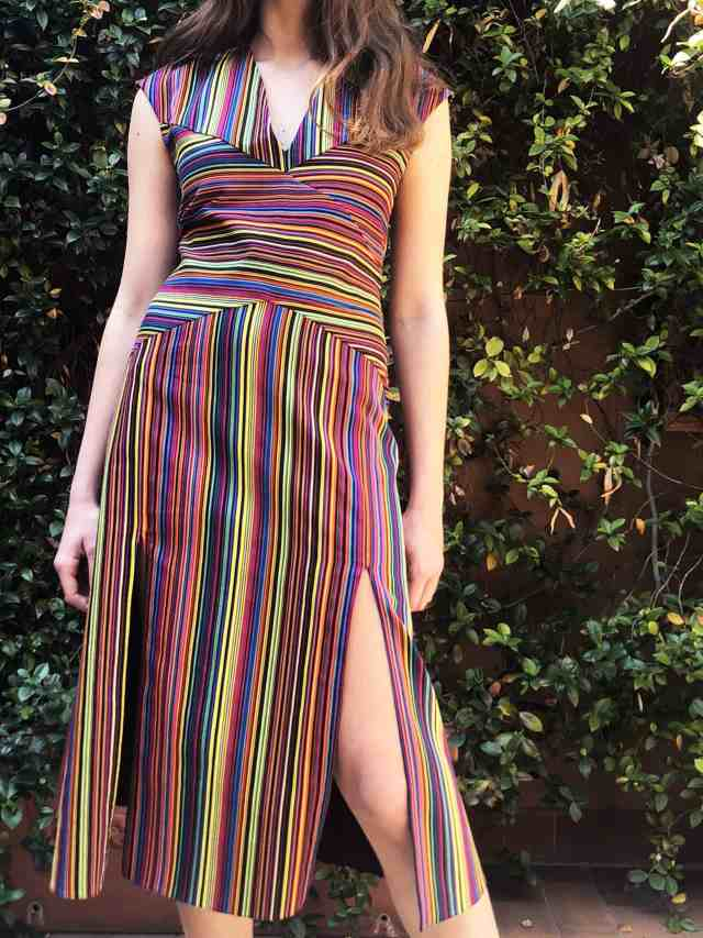 Baiadera multicolor cotton striped dress, intarsio cut at the waist and side slits.