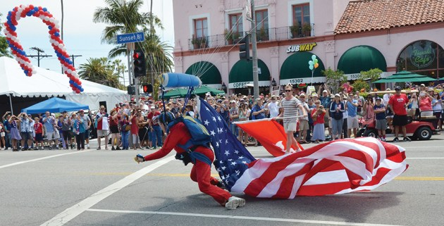 Carey Peck skydivers make a precise landing at Swarthmore and Sunset Boulevard to start the parade. Photo: Shelby Pascoe