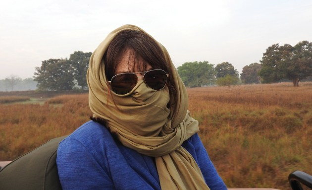 The author, Pepper Edmiston, protects herself from the air in India.