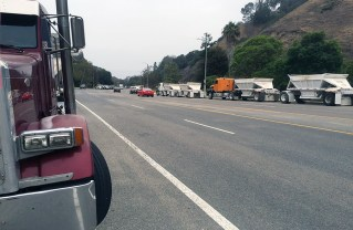 Trucks are lined up on both sides of Temescal Canyon Road early morning.