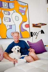 Artist Ed Massey at home with his dog, Milo. Photo: Lesly Hall