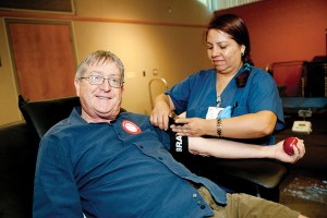 Red Cross nurse Adela Camargo took blood from donor Dan Huntington. Photo: Lesly Hall