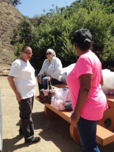 OPCC social workers Maureen Rivas (left) and Glanda Sherman (right) help a homeless woman find housing.
