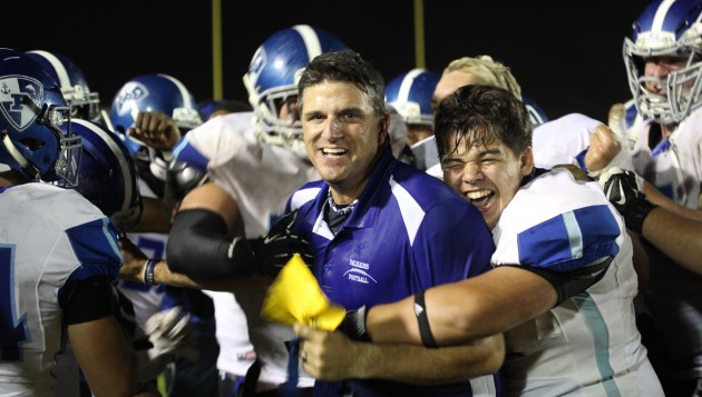 Players celebrate with Coach Tim Hyde after defeating Venice. Photo: Drew Vaupen