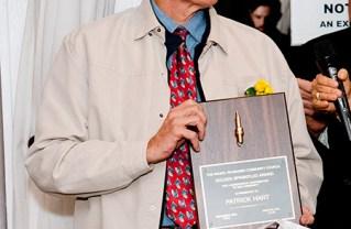 Patrick Hart with his Sparkplug award.