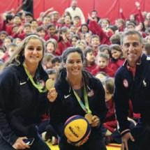 Gold Medal players Maddie Mussleman (left) Rachel Fattal and coach Adam Krikorian spoke to students at Village School. Photo: Chris Gonyaw