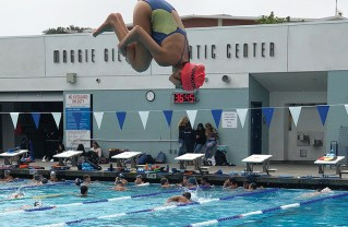Freshman Maya Salvitti works on her two-and-half in a tuck position.