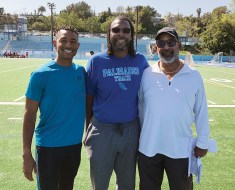 Jump coach Darryl Taylor (center) is joined by new track coaches Claudius Shropshire (left), who is assisting his dad Claudius Shropshire, Sr.