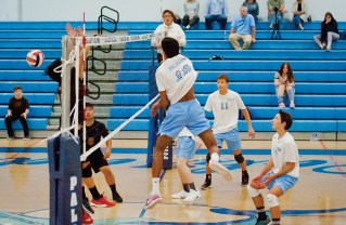 PaliHi's Akhil Tangutur (10) rises high to spike the ball against Westchester's defense, as Miles (11) and Marcus Partain (2) prepare to react. Photo: Lesly Hall Photography