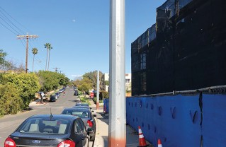 "teel poles (""guy stubs"") provide structure support for other electrical poles on Albright."