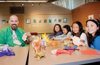 Travis Taft and origami students Hannah Benharash, Kai Simi-Ottinger, Nicole Nguyen and Sabrina Hall at his monthly Palisades Library class. Photo: Lesly Hall Photography