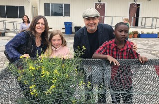Janice and Billy Crystal attended the Marquez Elementary Edible Garden celebration on May 30. Third graders Eleanor Buckner and Dezmen Howard explained the Three Sisters Garden.