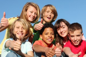 group of happy youth club or summer camp kids