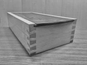 Japanese Wood Joinery Nejiri Arigata on a wooden box