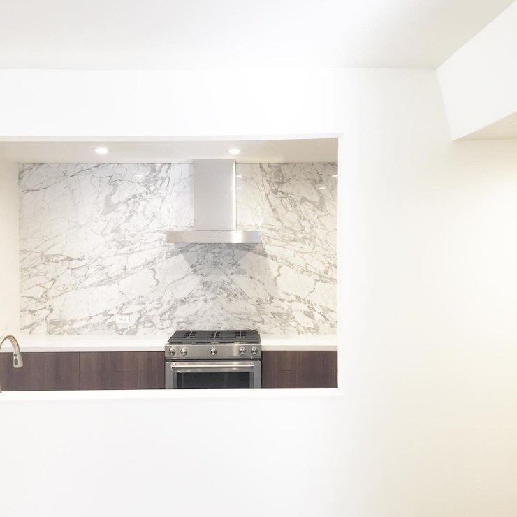 Kitchen Cabinets with Walnut, with Full Bookmatched Backslab