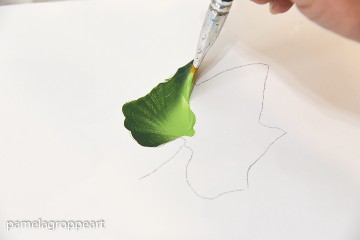 painting a pumpkin leaf in folk art acrylic paints