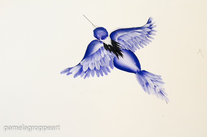 Paint white feathers on neck of flying blue bird