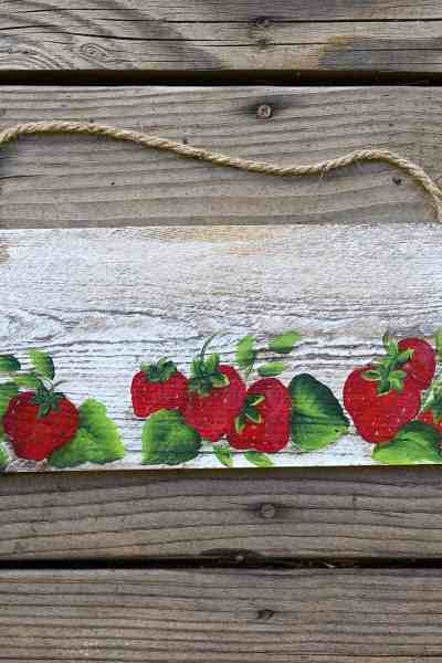 Strawberries painting on a board with rope hanger