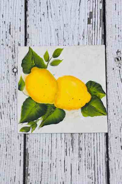 lemons painted on canvas board.