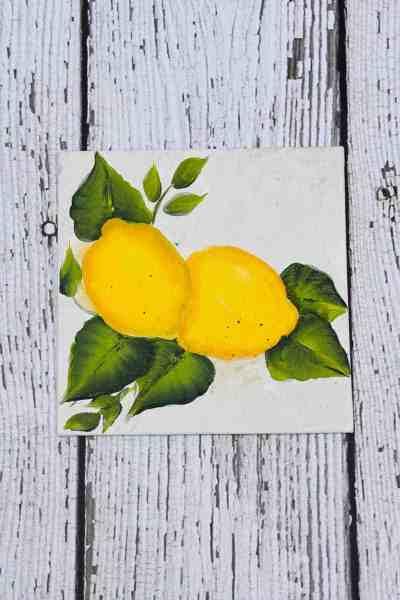 lemons painted on canvas board.