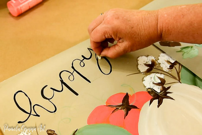Fixing mistake on happy fall lettering for diy sign