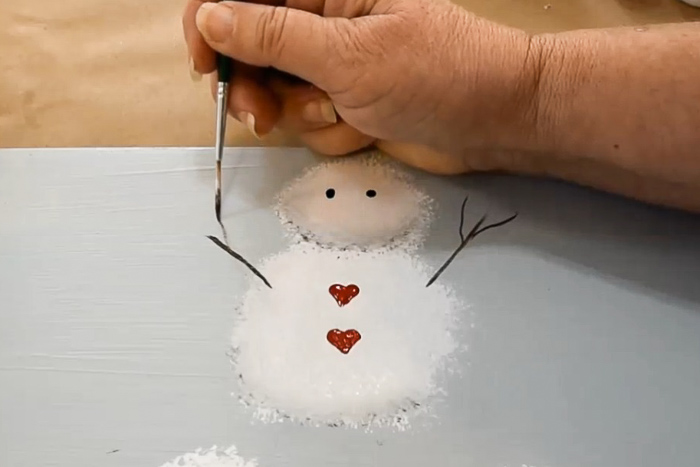 paint snowman arms