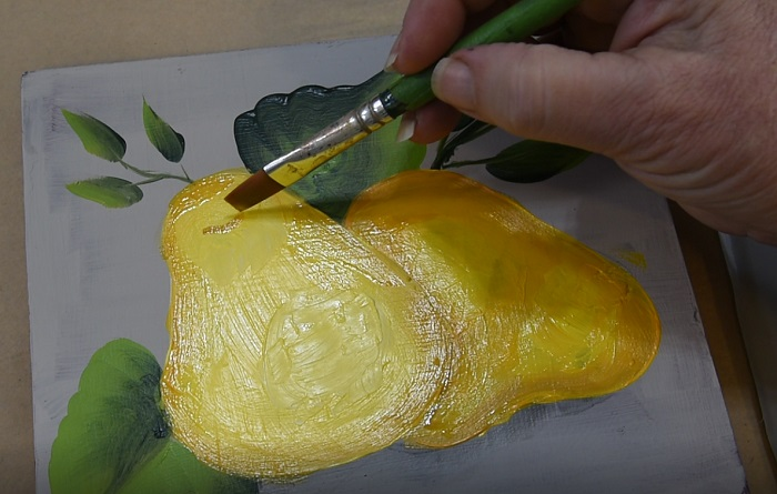 add a small smile to create pear stem base