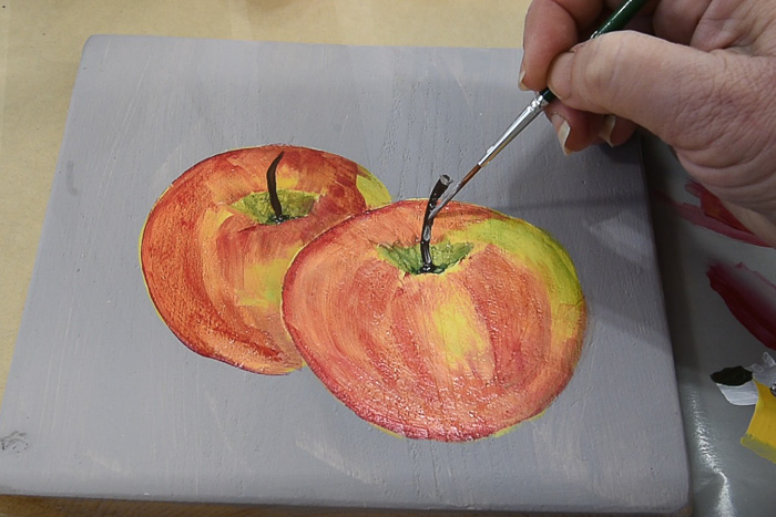 adding a stem to apple painting, pamela groppe art