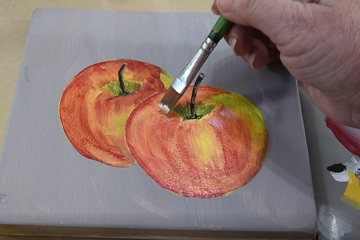 Adding highlights to apples, pamela groppe art