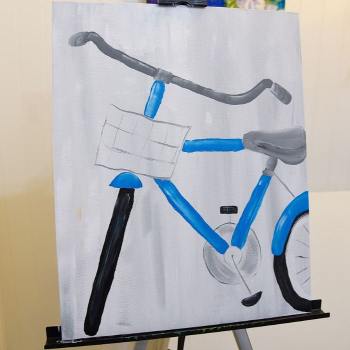 Paint petals and gear of bicycle painting