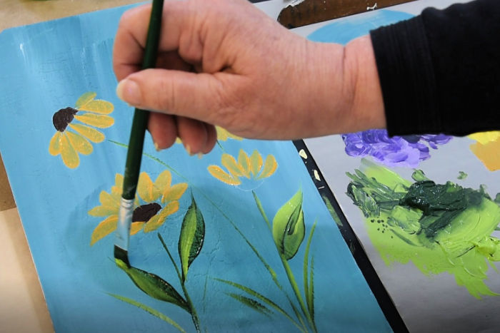 Paint flower stems and paint leaves with a sliding stroke
