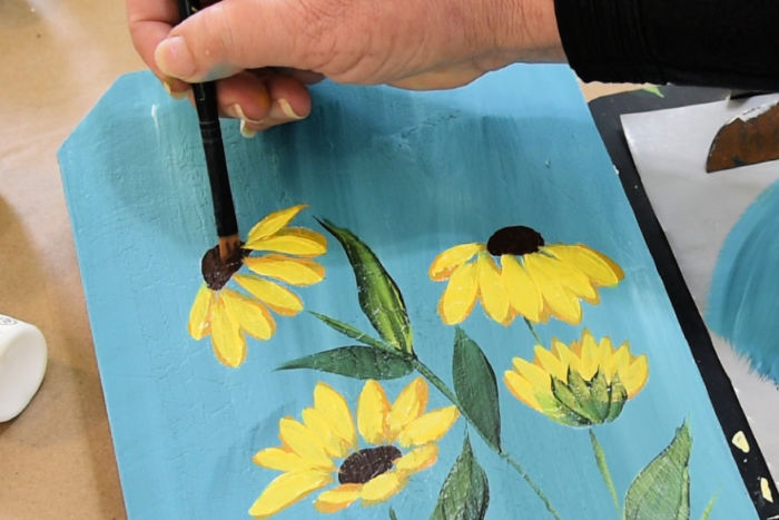 Using Burnt Umber clean up edges of flower center where the Yellow petals crossed into it