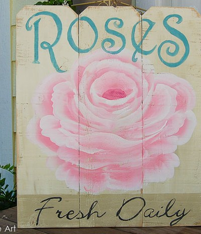 Rose advertising diy sign on cedar fence boards