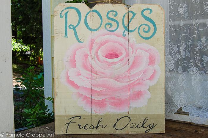 Rose advertising diy sign on cedar fence boards