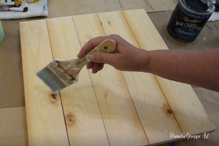 sealing wood pallet board with sealer
