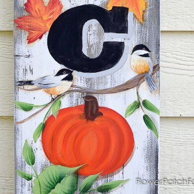 pumpkin, chickadee and leaves painted on wood sign