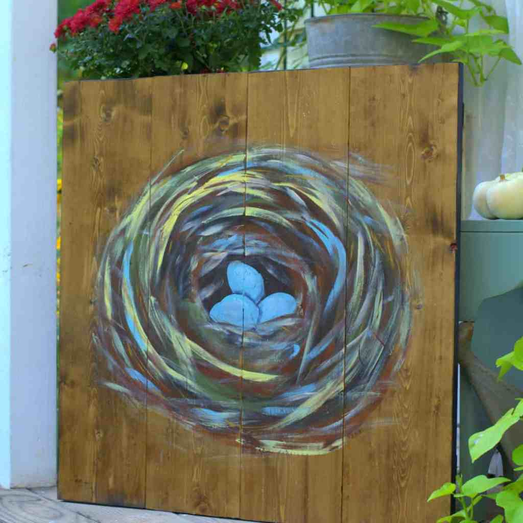 paint a birds nest on a wood pallet