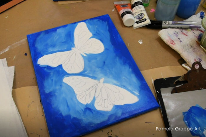 As you paint Cerulean blue add white towards center of canvas