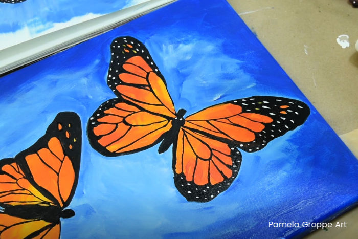 add final details to monarch butterfly painting