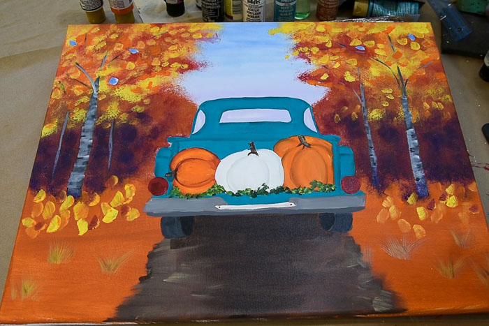paint white pumpkin and add finishing touches to painting