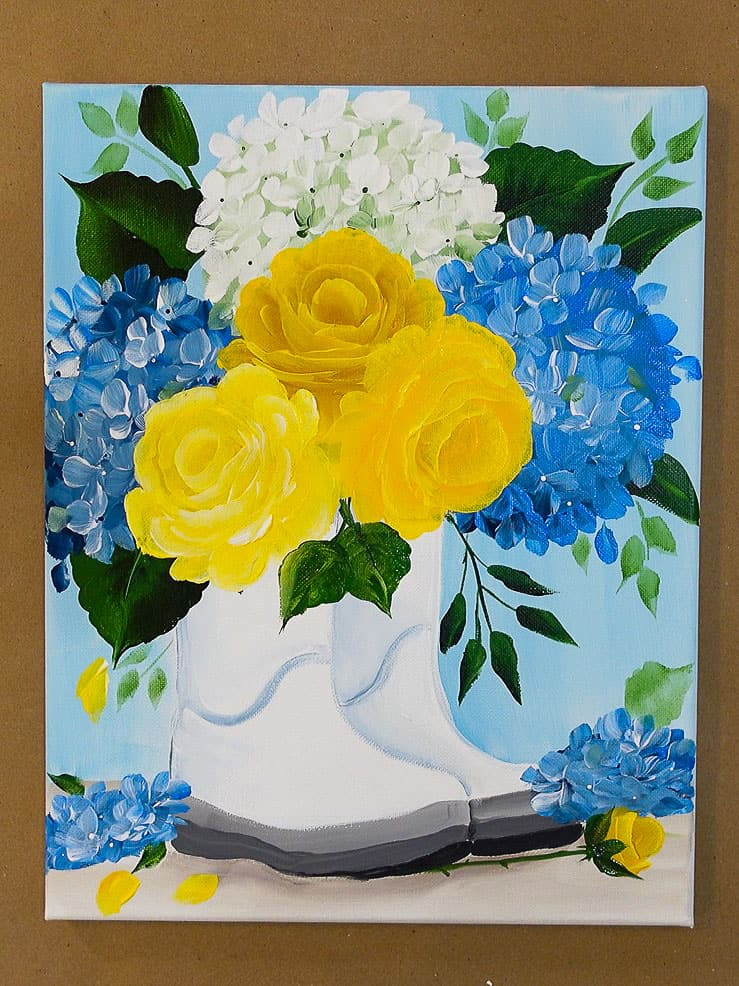 yellow roses and blue hydrangeas in rainboots painting
