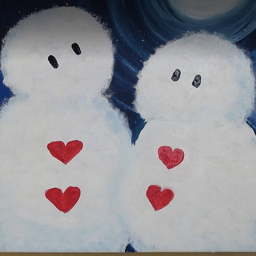 heart buttons and black oval eyes painted on snowman and snow lady