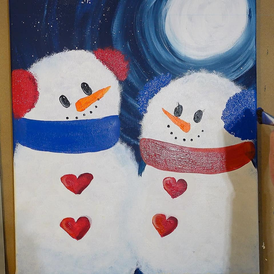 pounce red ear muffs on snowman and blue on snow lady in semi circles