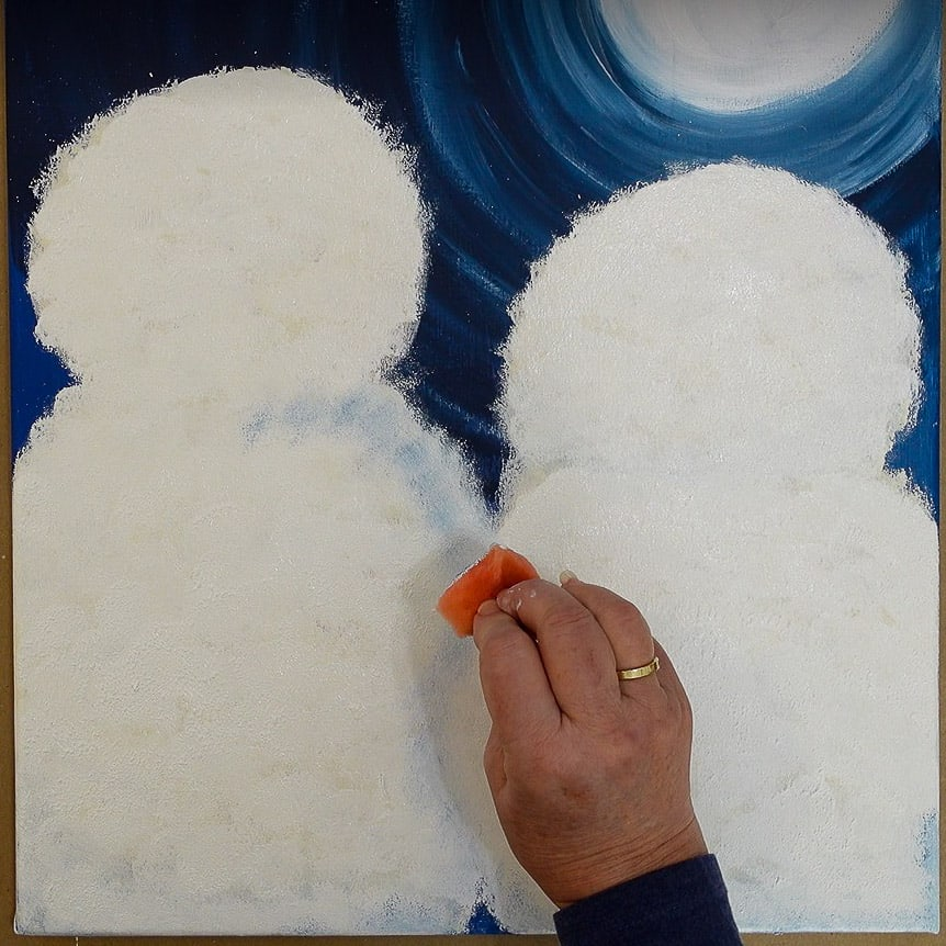 create shading by sponging on blue into wet white paint