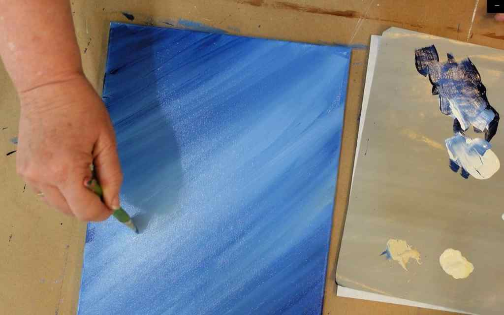 Blend prussian blue with white to graduate colors of background of rooster painting